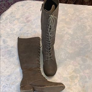Brown lace up boots with side zippers